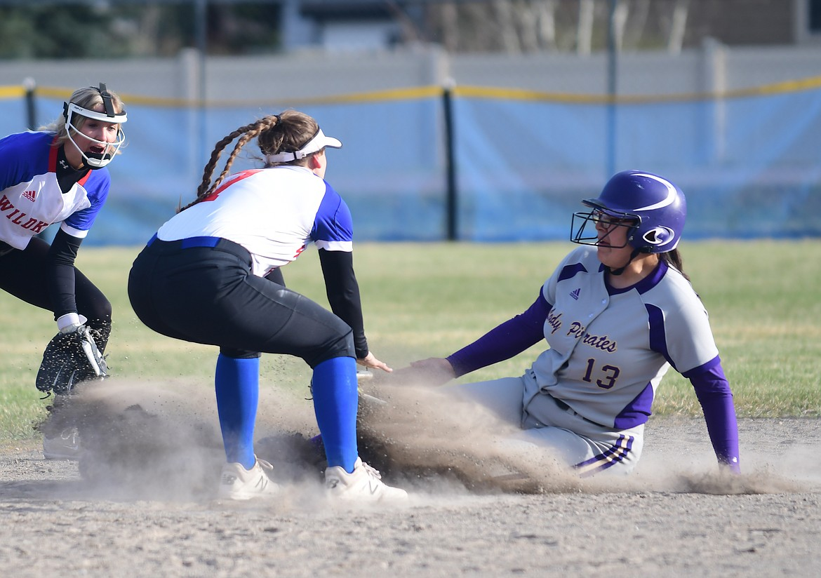 Mossy Kauley slides into second base against Columbia Falls. (Teresa Byrd/Hungry Horse News)