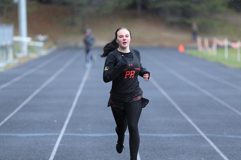 Allyson Dickinson runs the 400 on Saturday.