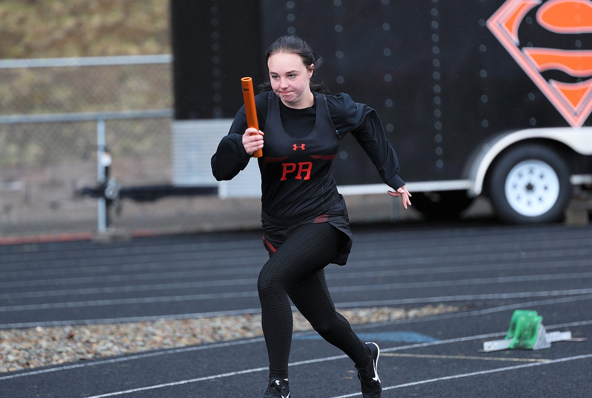 Allyson Dickinson runs the first leg of the 4x100 relay on Saturday.