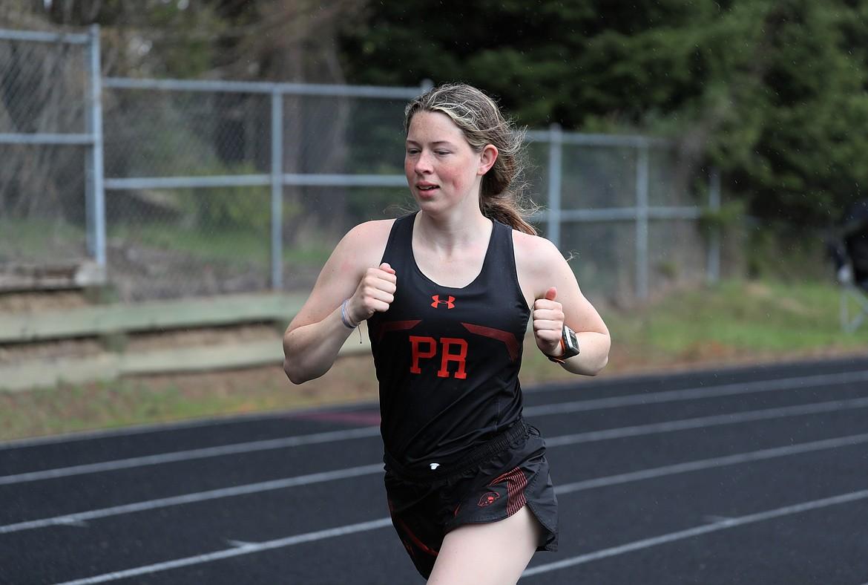 Annika Rantala runs the 3200 on Saturday.