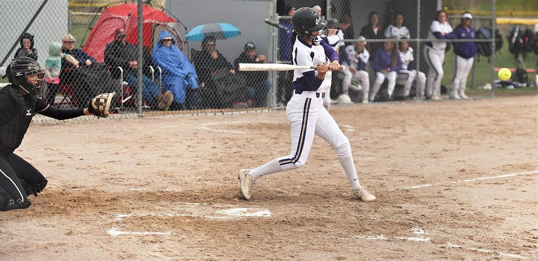 Josie Caye takes a swing against Browning. (Scot Heisel/Lake County Leader)