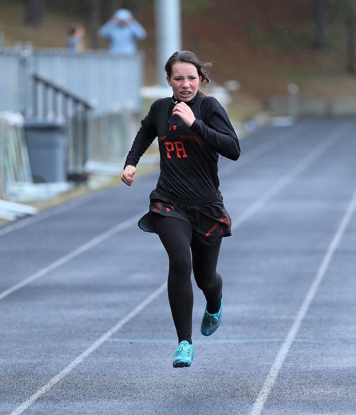 Elisheva Davis runs the 200 on Saturday.