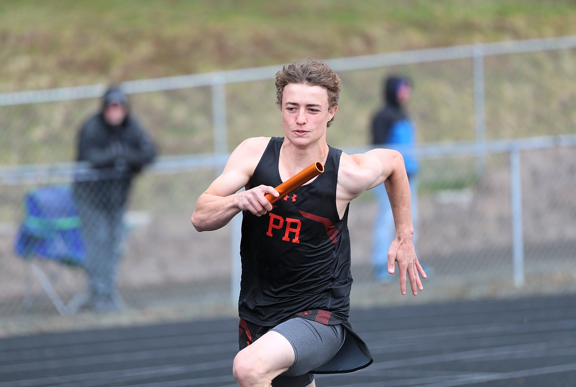 Erik Deem competes in the 4x100 relay on Saturday.