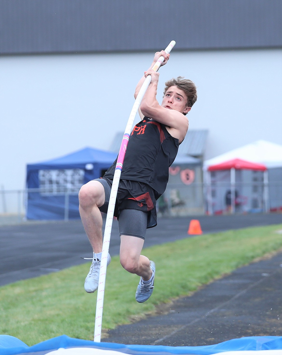 Erik Deem takes off in the pole vault on Saturday.