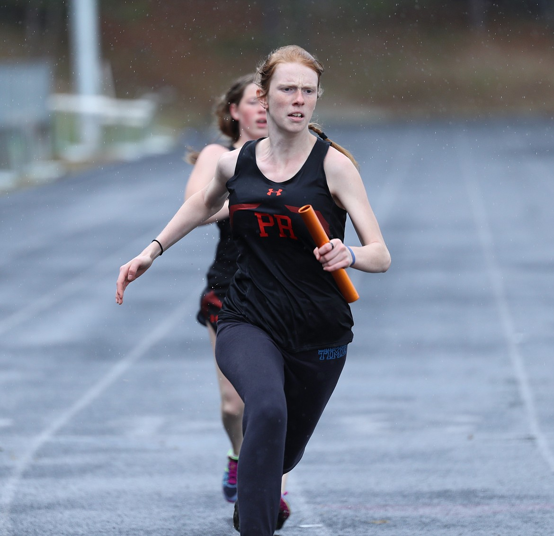 Erika Swoboda runs in the sprint medley.