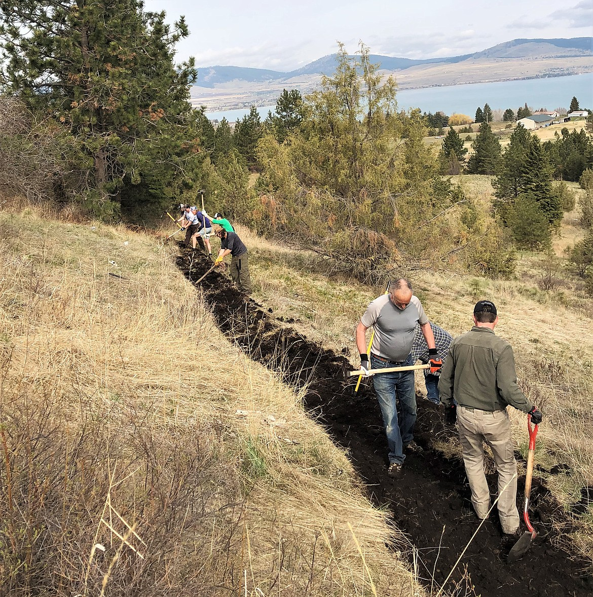 A new foot and bike path will be completed by the end of May in the Ridgewater development overlooking Polson and Flathead Lake. The trail has been entirely built by volunteers, with the permission of the landowners, the Maddy family. (Courtesy of Mike Windauer)