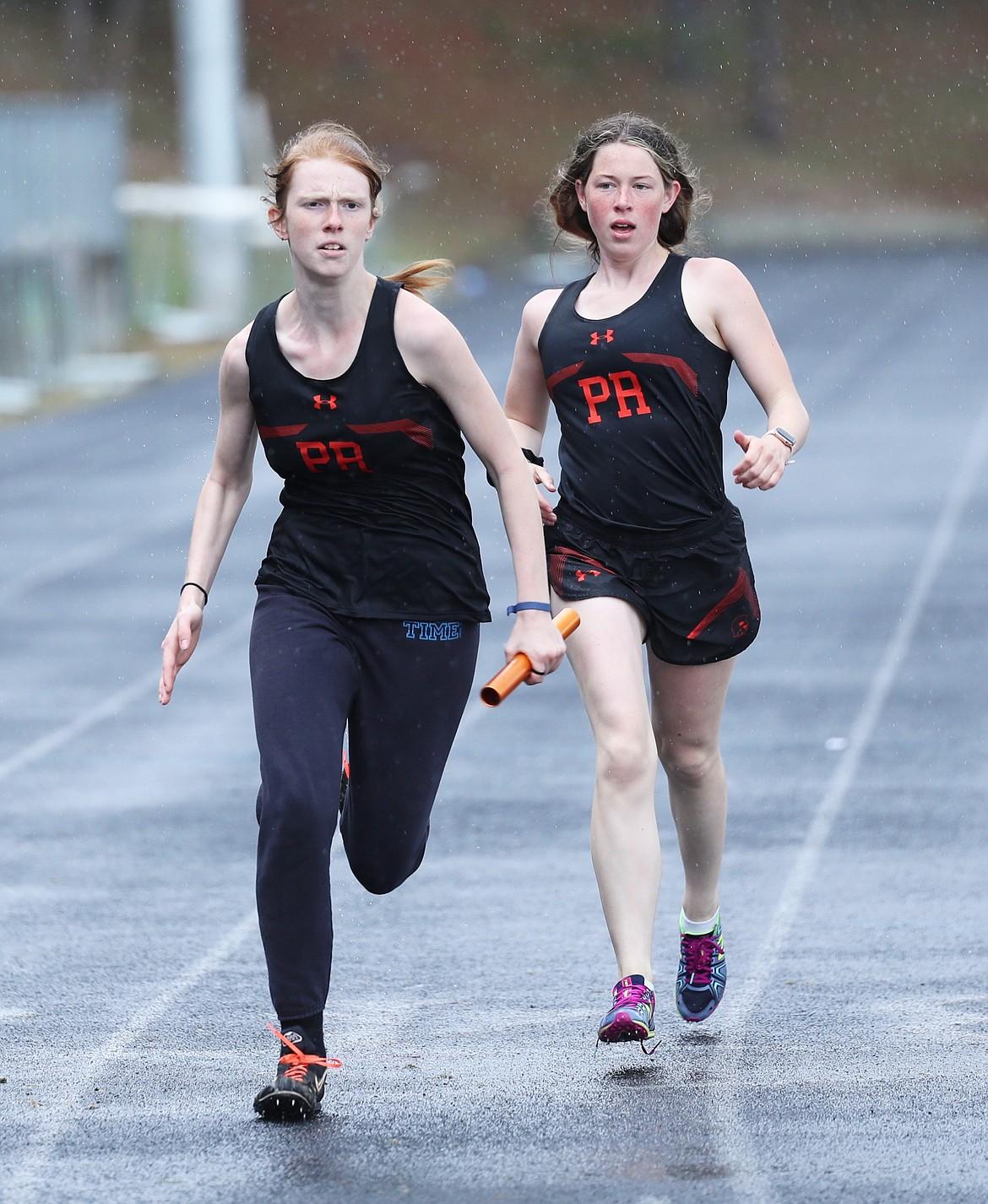 Erika Swoboda (left) receives the baton from Annika Rantala in the sprint medley.