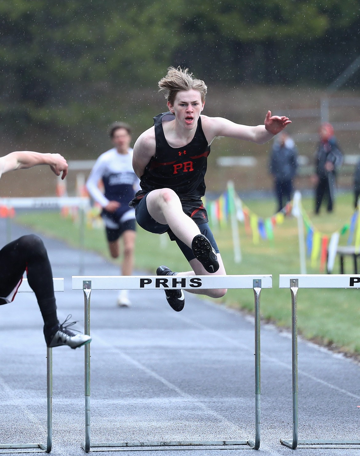 Shane Gamber clears the final hurdle in the 300 hurdles on Saturday. He placed second in the event with a PR.