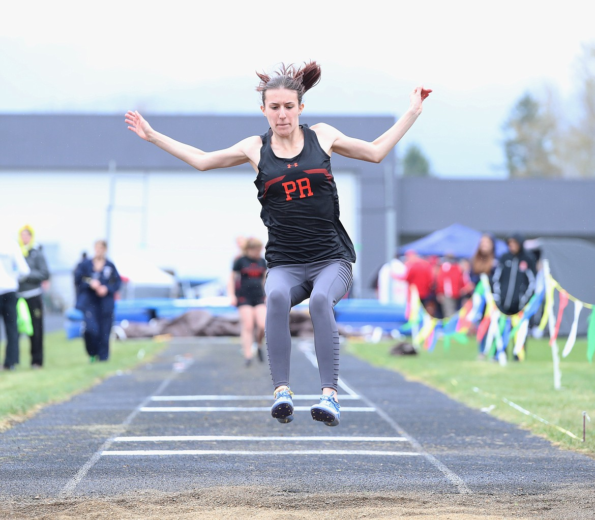 Alyssa Clement leaps into the pit in the long jump.