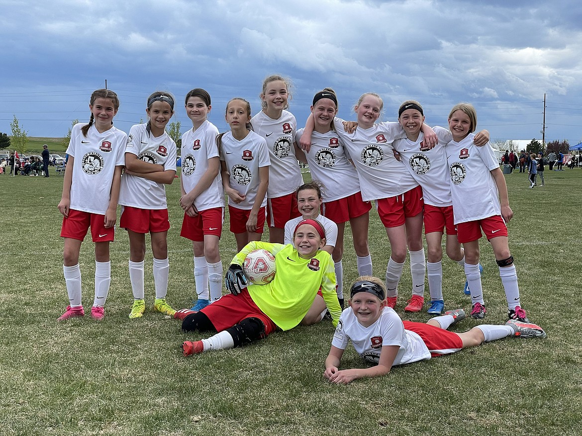 Courtesy photo The Thorns 09 Girls Yellow soccer team played in the Performance Cup in Boise this past weekend. The Thorns won their first game 4-1 (Chloe Burkholder with 4 goals) against Idaho Inferno 09 Girls Copa from Caldwell. Their second game on Saturday vs. Urban Soccer Academy 09G Black from Boise was a win, 4-3, (Burkholder with 3, Audrey Linder 1). Sunday, they competed against Ignite Soccer Club U12 and won 2-0 (Lucia Barton, Olivia Smith with one goal each). Madeline Witherwax was in goal all weekend. In the front row from left are Audrey Linder, Madeline Witherwax and Ashley Yates; and back row from left, Catherine Storey, Mallory Morrisroe, Adelynn Blessing, Brooklyn Leen, Taryn Young, Chloe Burkholder, Nell Dodge-Hutchins, Olivia Smith and Lucia Barton.