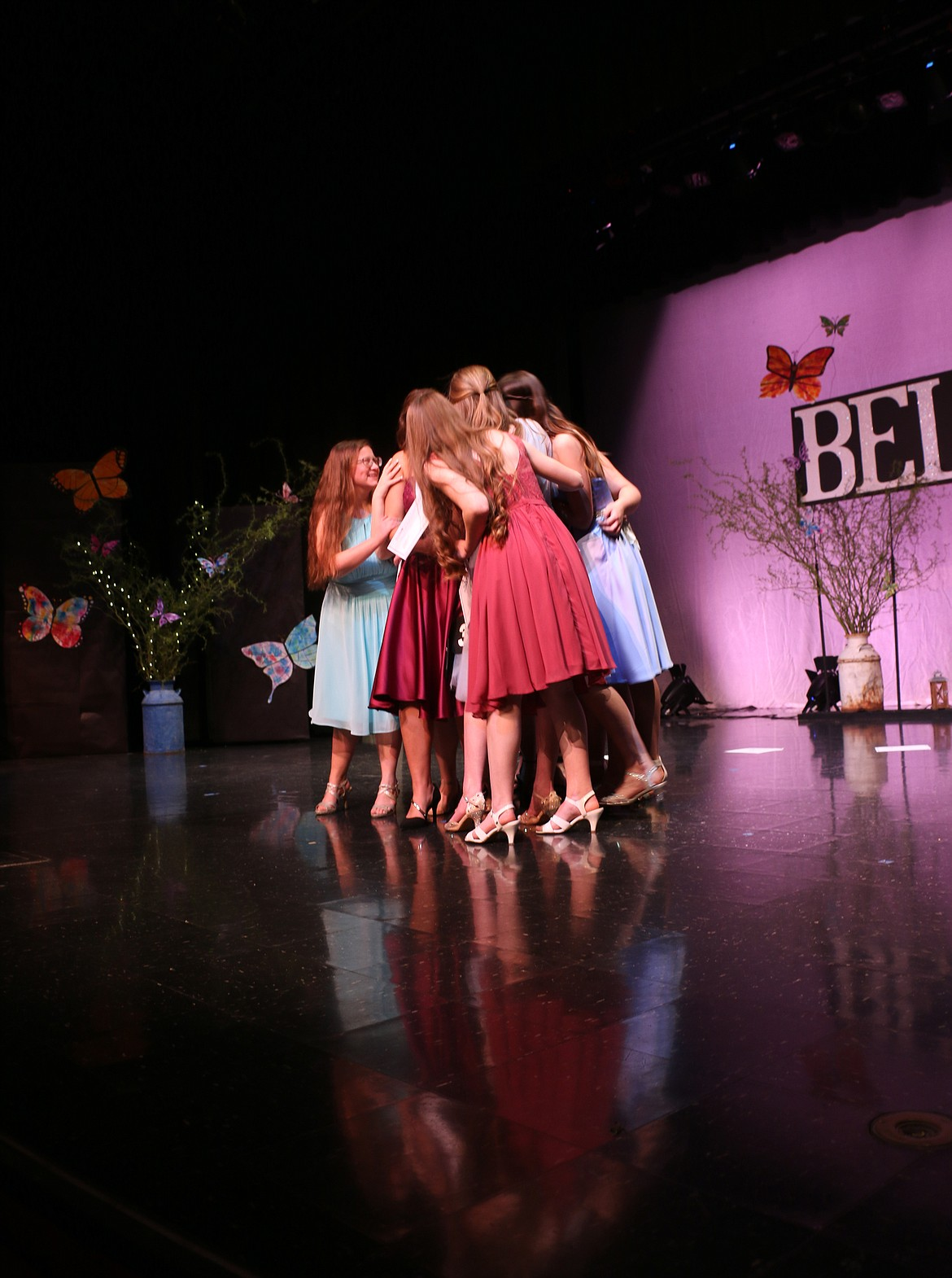 Distinguished Young Woman for Bonners Ferry participants surround Cali Iacolucci after she was selected as the community's Distinguished Young Woman for 2021-'22 on Saturday.