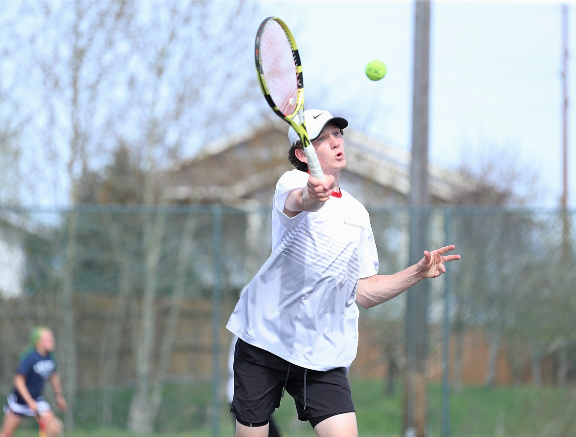 Josh Embree drives toward the net and hits a volley on Thursday.