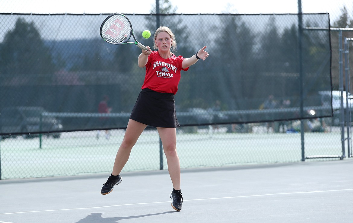 Patch Howard returns a serve during a mixed doubles match on Thursday.