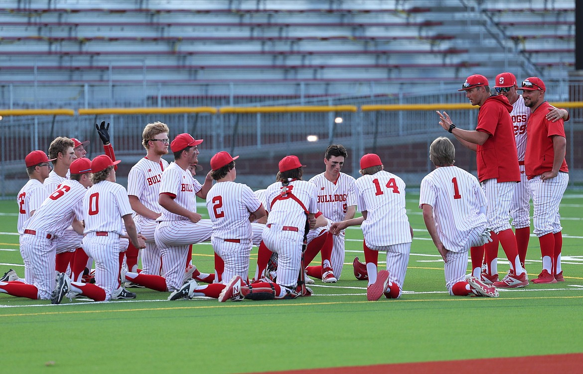 Head coach Chase Tigert talks to the team following Thursday's doubleheader against Lewiston.