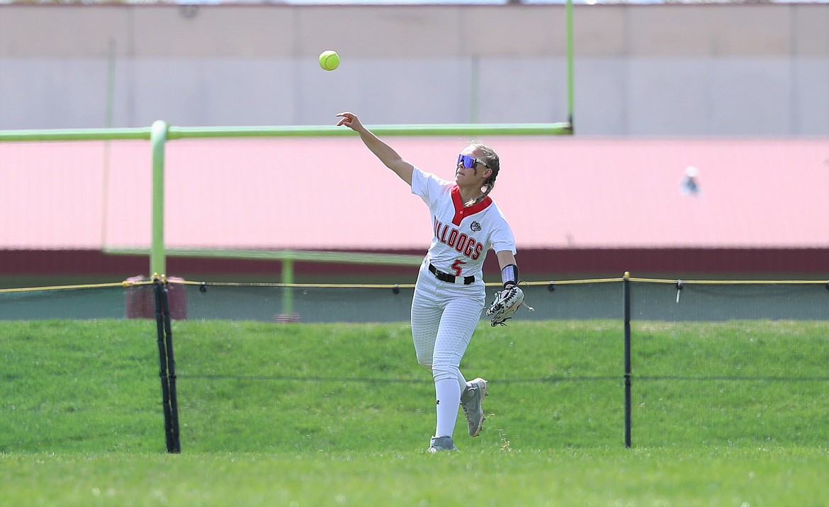Jacey Cash makes a throw from center field on Saturday.