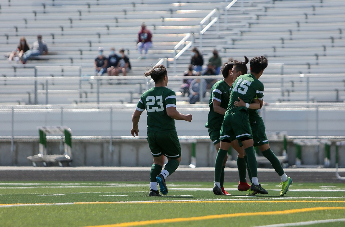 Quincy High School players celebrate together after winning the Battle of the Basin against Ephrata High School in penalty kicks on Saturday afternoon at QHS.
