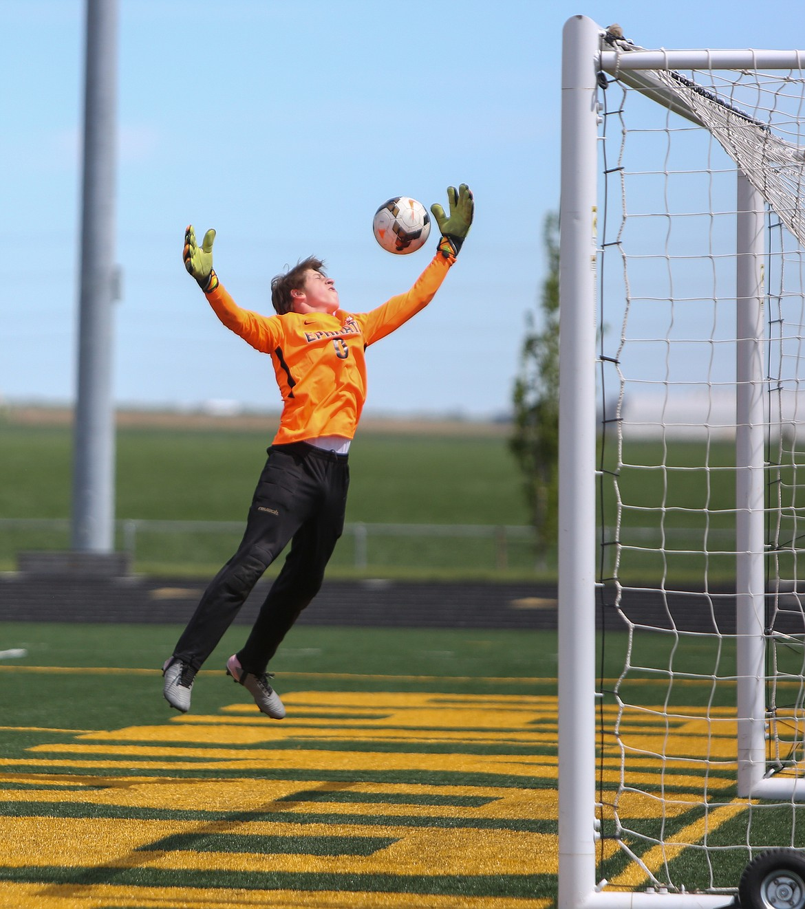 Ephrata High School goalkeeper Kelvin Sager skies up to deflect a shot from Quincy on Saturday afternoon at Quincy High School.