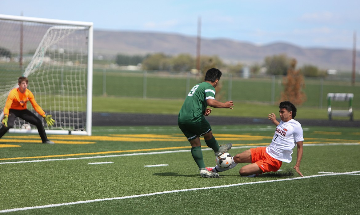 Ephrata's Cristobal Soltero Zepeda blocks a shot from Quincy's Jorge Nuñez in the second half of the Battle of the Basin in Quincy on Saturday.