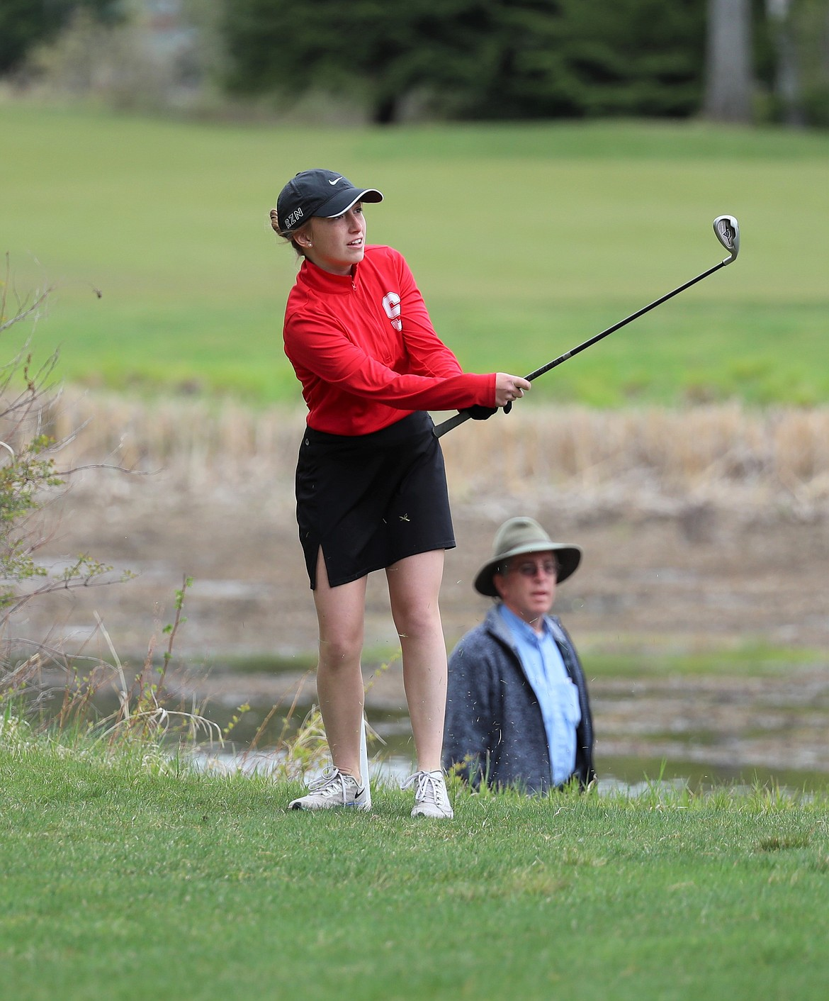 Camille Neuder hits a chip on Monday.