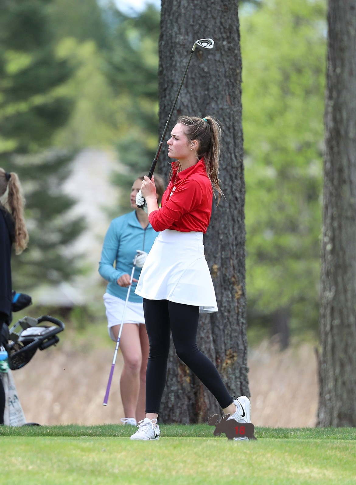 CeCe Deprez holds her follow through on a tee shot on Monday.
