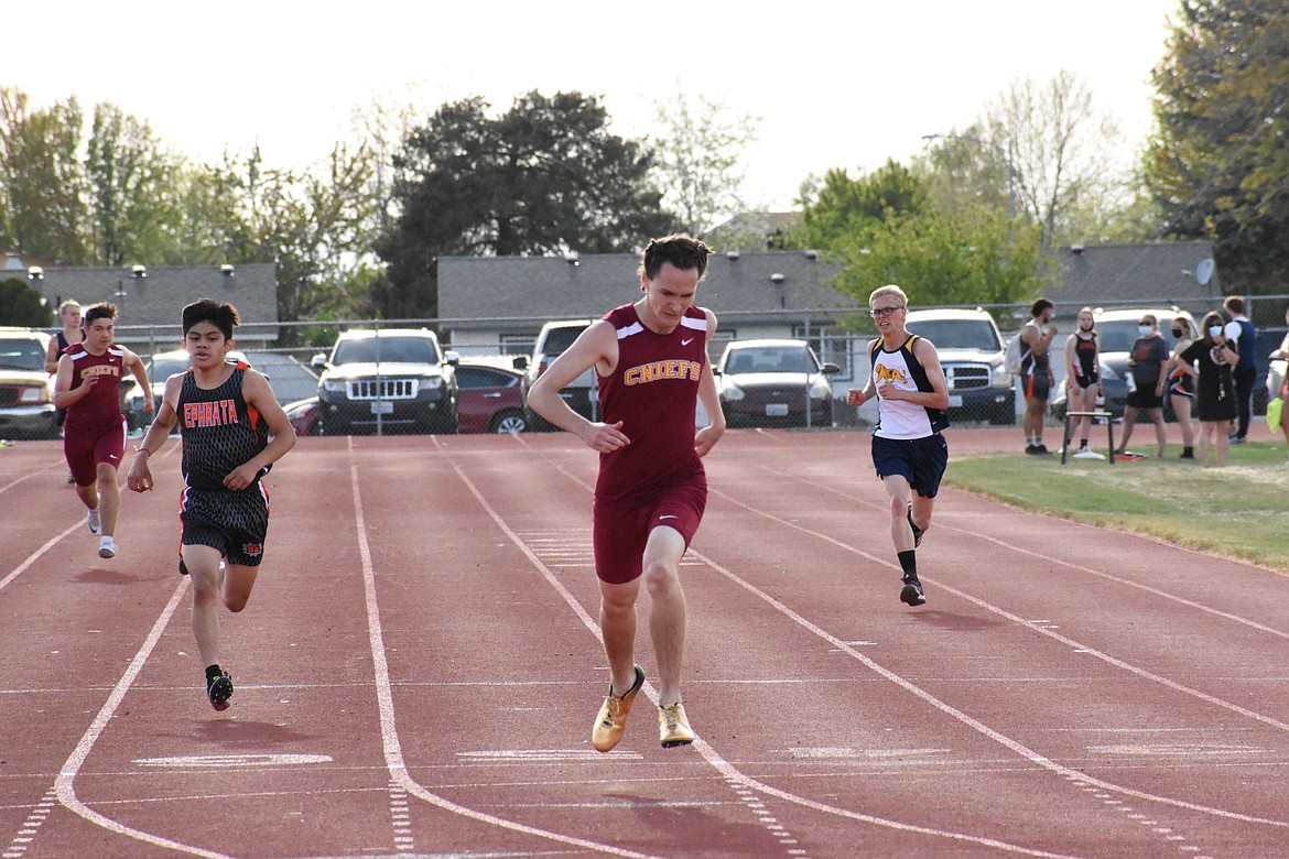 Moses Lake's Curtis Miller leads the pack with Ephrata's Edgar Rojas, left, in close pursuit at the North Central Washington Region track & field meet at Moses Lake High School last Thursday