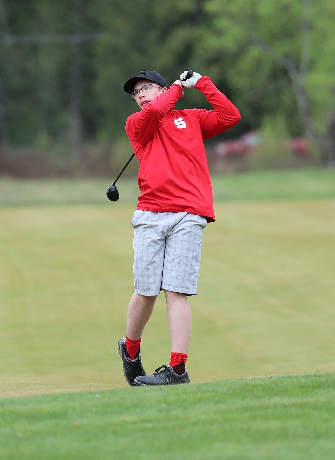 Dawson Owens holds his follow through on a shot from the fairway on Monday.