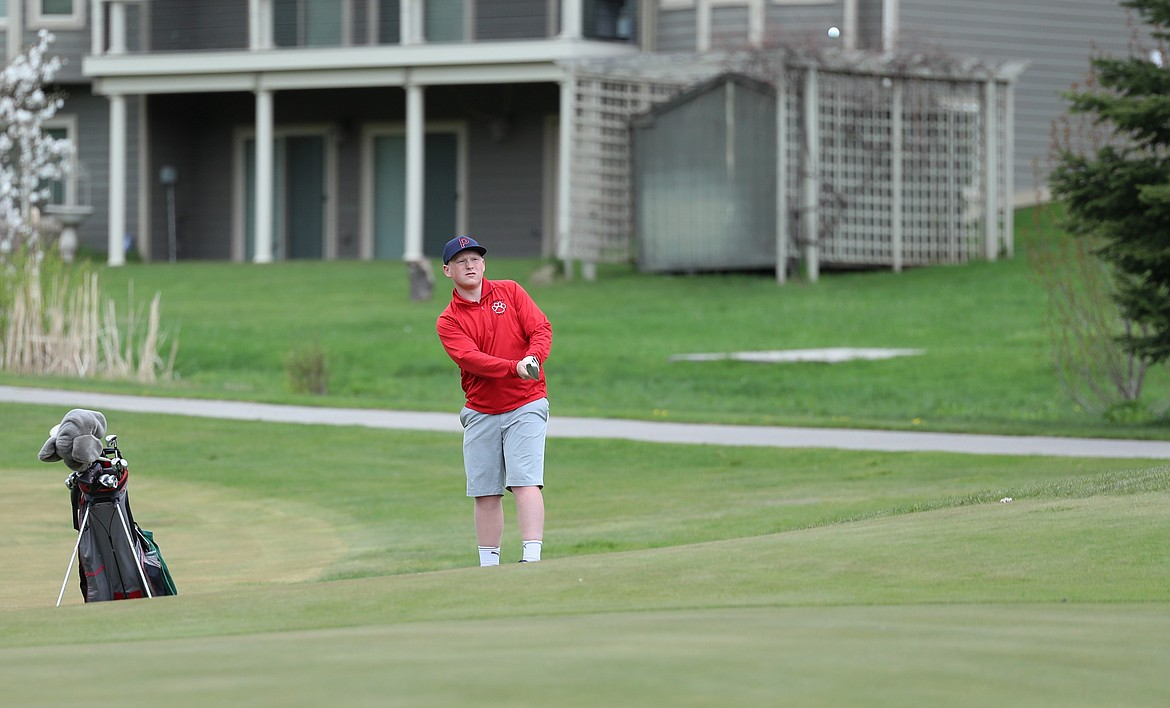 Harley Wilks chips the ball onto the green on Monday.