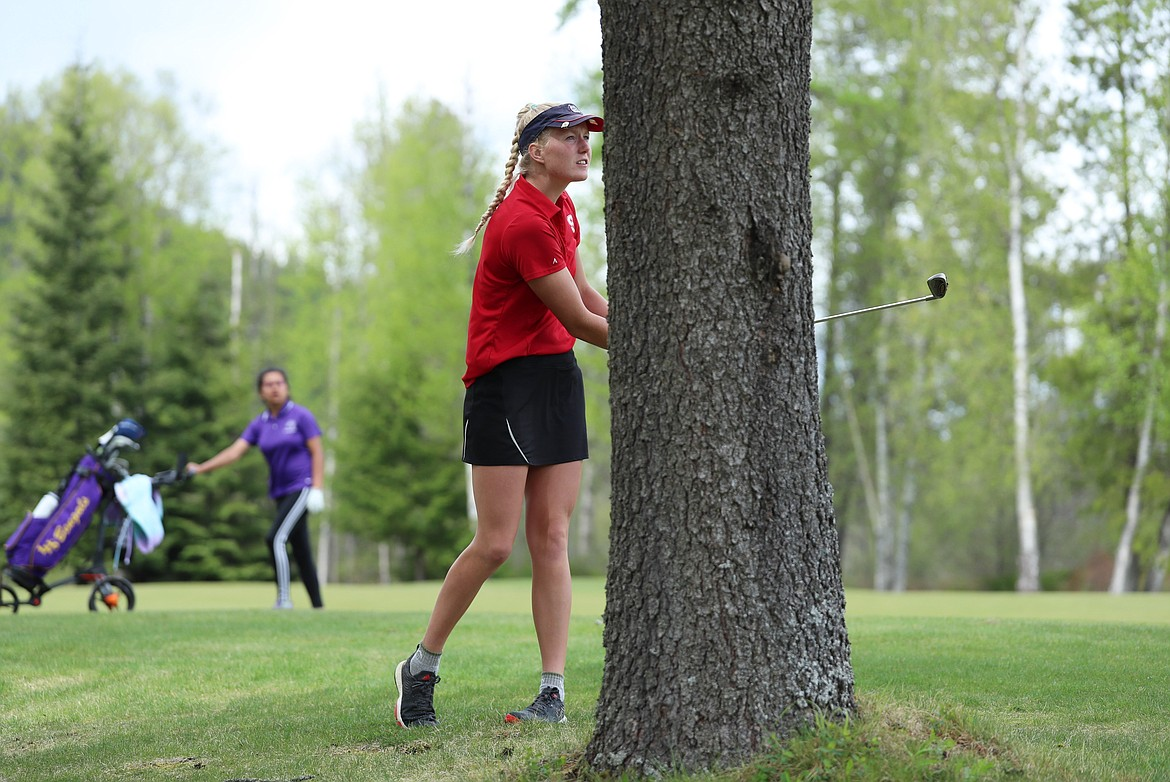 Hattie Larson hits a shot from the rough on Monday.