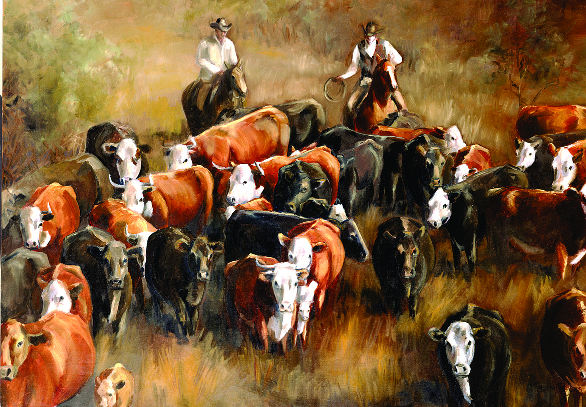 Painting of cowboys herding the cattle.