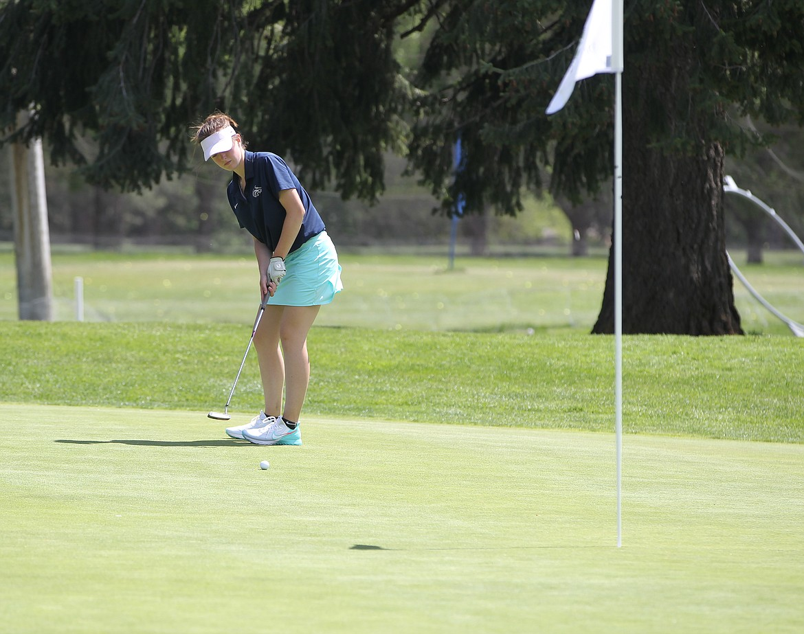 MARK NELKE/Press Ashlyn Shanley putts on the 18th green at Avondale Golf Club in Hayden Lake on Monday in the first round of the state 5A golf tournament.