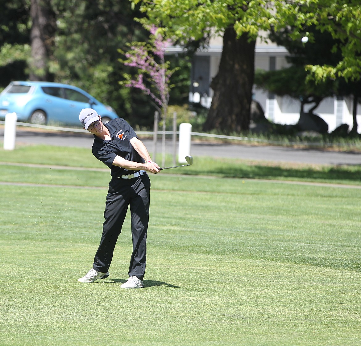 MARK NELKE/Press Boen Torgerson of Post Falls chips on the ninth hole at the state 5A golf tournament Monday at Avondale Golf Club in Hayden Lake.