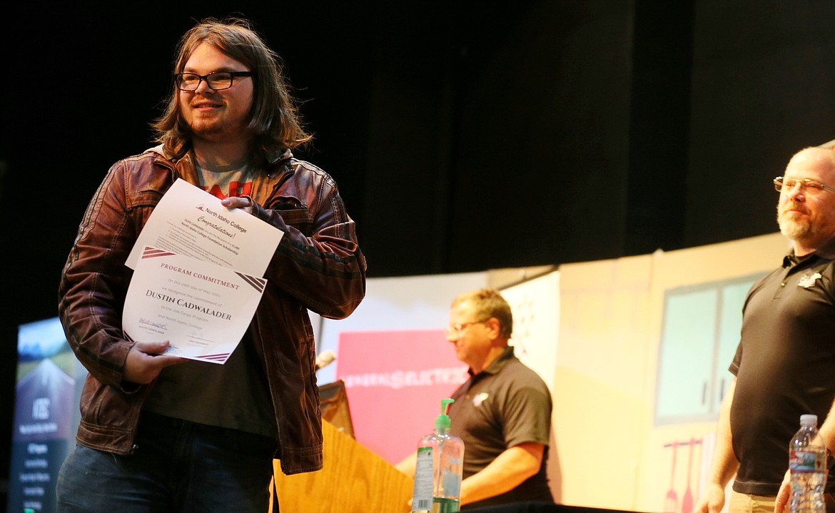 Mountain View Alternative High School senior Dustin Cadwalader looks out at the audience after committing to enroll in North Idaho College's Job Corps program during a signing ceremony Thursday. Dustin was one of the seniors who received a $1,000 scholarship.
