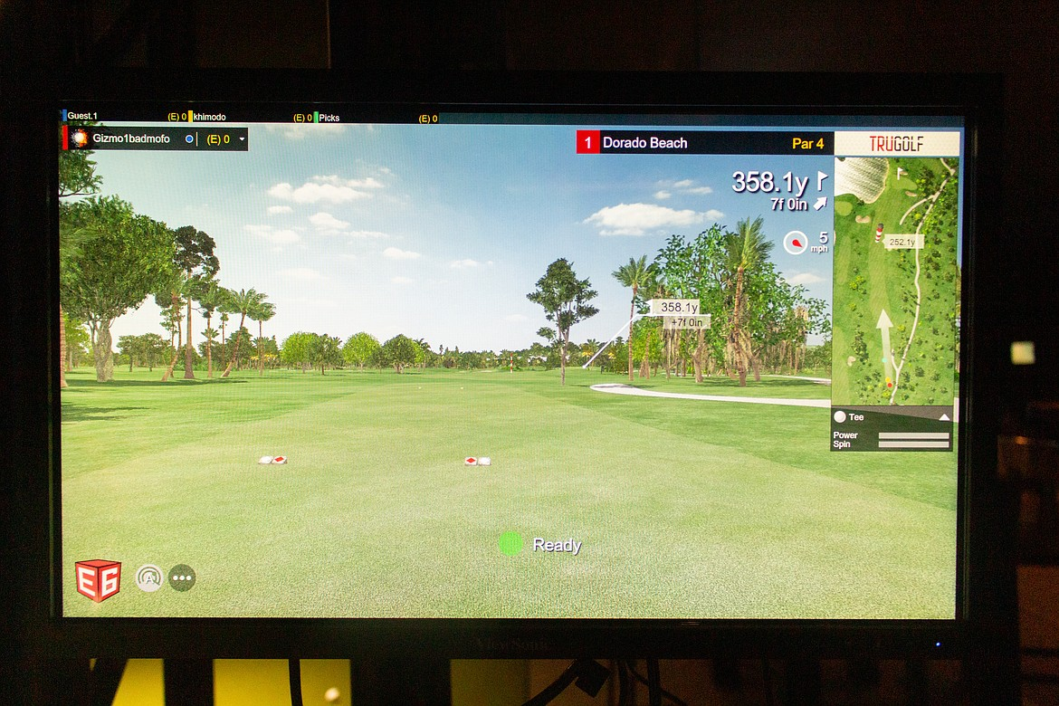 A look out across the virtual fairway at Dorado Beach, one of numerous courses available at Divots Indoor Golf facility in Moses Lake.