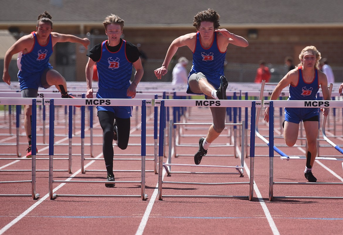 Isak Epperly clears the final hurdle on his way to winning the 110 hurdles at the Western B Divisional Meet in Missoula Saturday. Wyatt Duke (left) was third, Jordan Betts (far left) was third and Wyatt Johnson (right) took fifth. Jeremy Weber/Bigfork Eagle