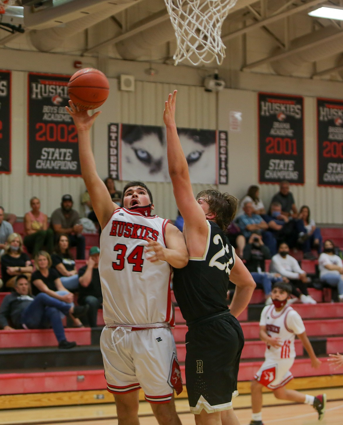 Othello's Julian Alegria fires a shot up in the paint for the Huskies in the second half at home against Royal High School on Saturday afternoon.