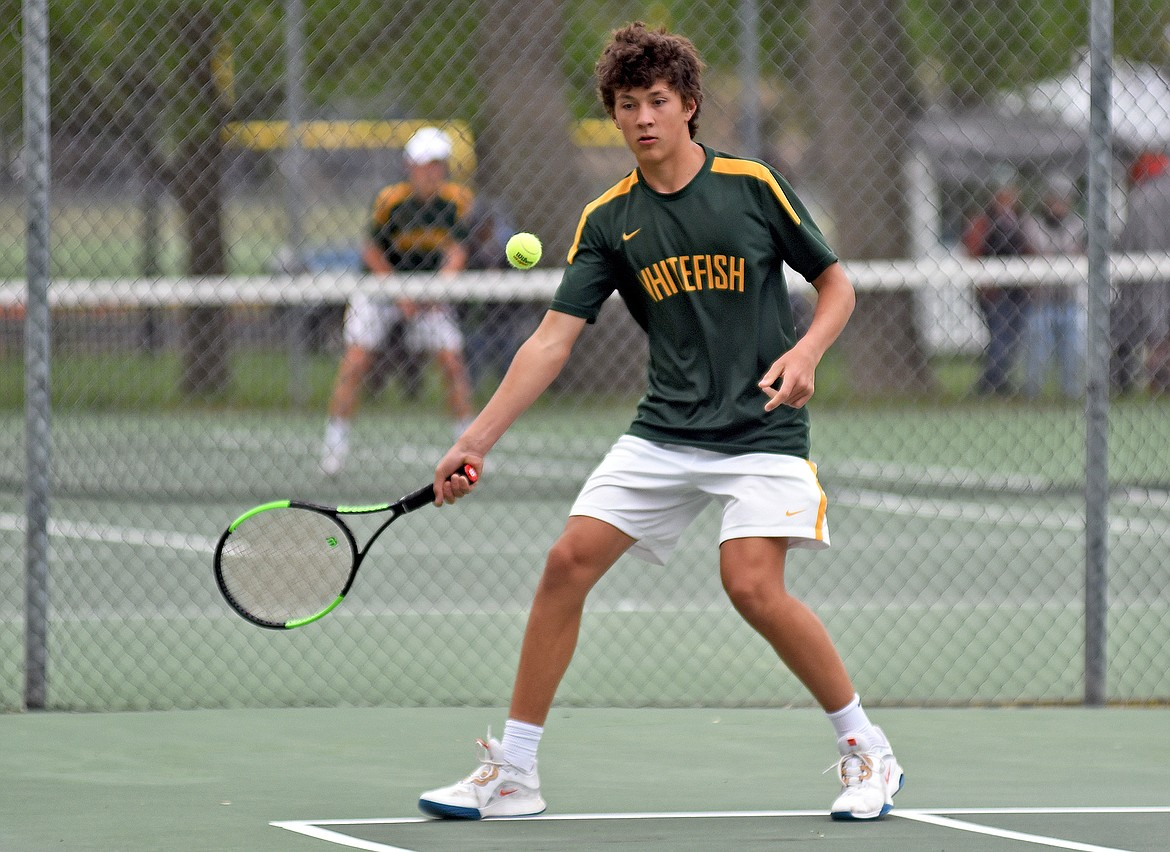 Bulldog Mason Kelch plays in a doubles match at the State A tennis tournament in Billings on Friday. (Whitney England/Whitefish Pilot)
