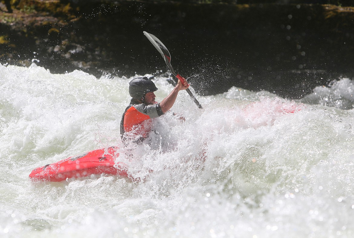 A kayaker paddles through a patch of whitewater along the Wild Mile at the Bigfork Whitewater Festival on Saturday, May 29. Mackenzie Reiss/Bigfork Eagle
