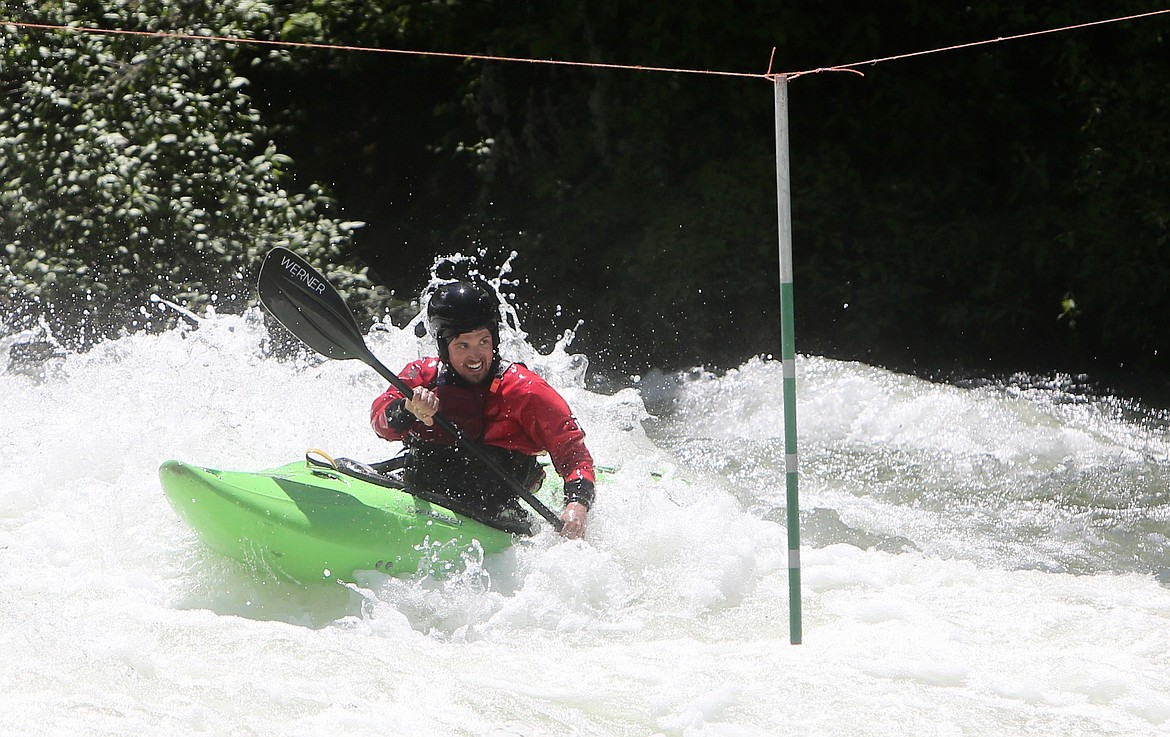A competitor fights to round a marker at the Bigfork Whitewater Festival on Saturday, May 29. Mackenzie Reiss/Bigfork Eagle