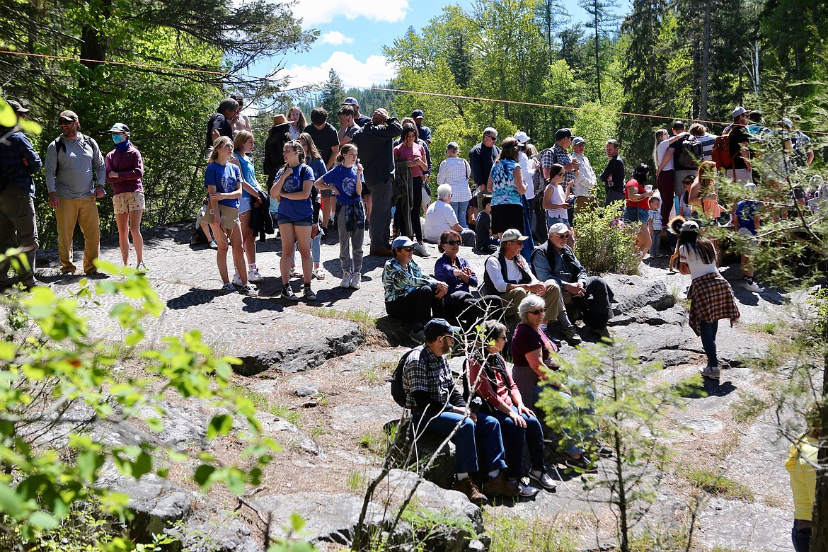 Spectators gather at the Big Rock along the Swan River Nature Trail to catch the action at the Bigfork Whitewater Festival last Saturday. Mackenzie Reiss/Bigfork Eagle