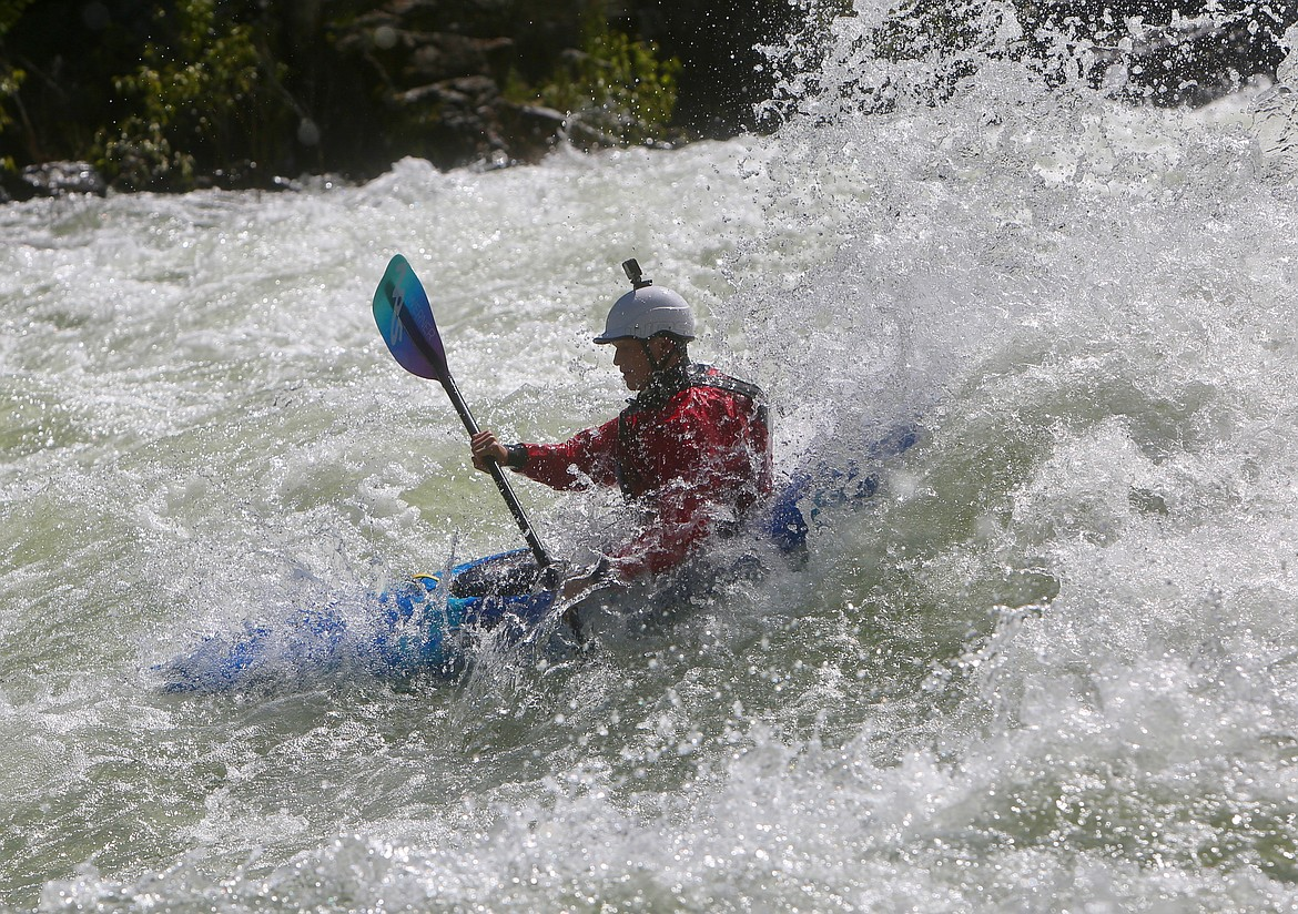 A competitor tears through a patch of whitewater along the Wild Mile at the Bigfork Whitewater Festival on Saturday, May 29. Mackenzie Reiss/Bigfork Eagle