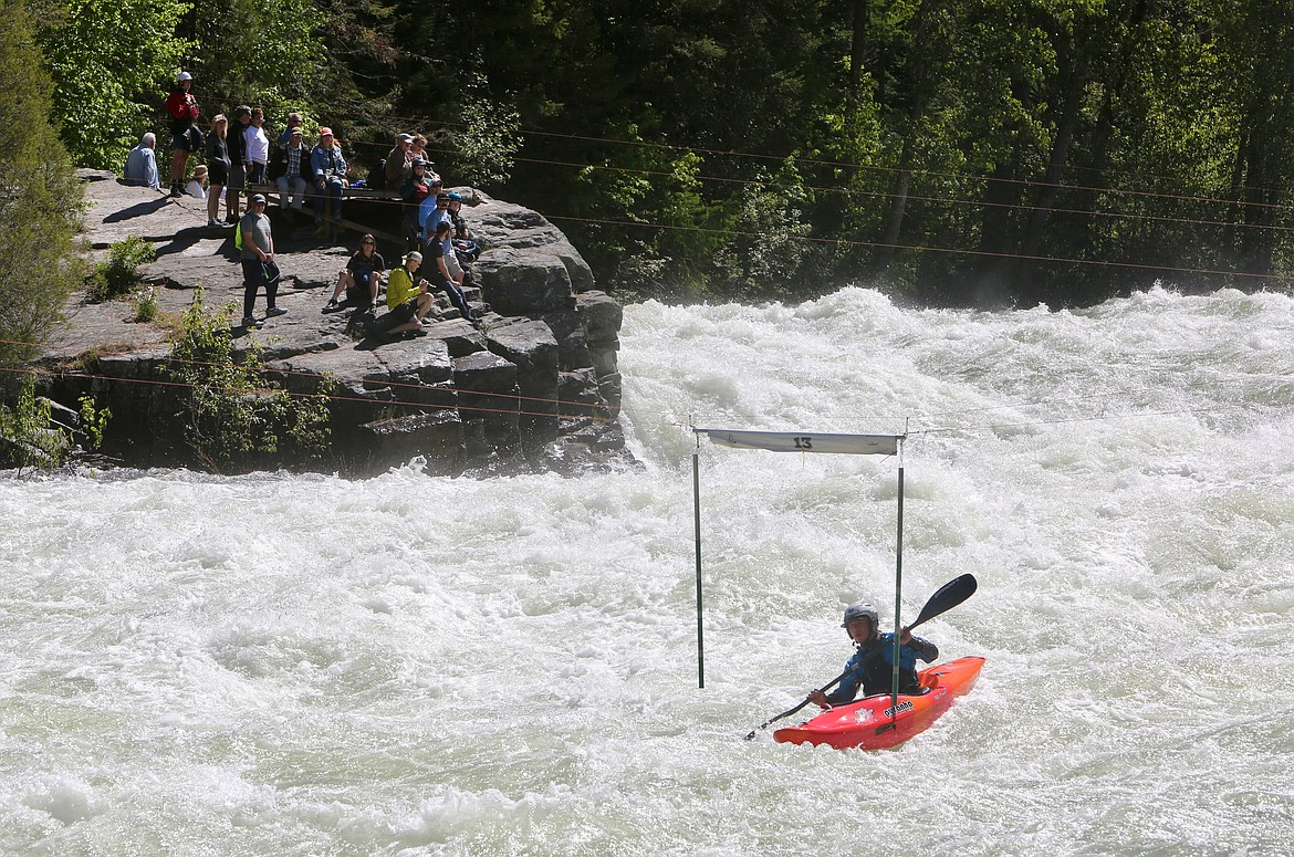 A kayaker passes through a gate during the Bigfork Whitewater Festival on Saturday, May 29. Mackenzie Reiss/Bigfork Eagle