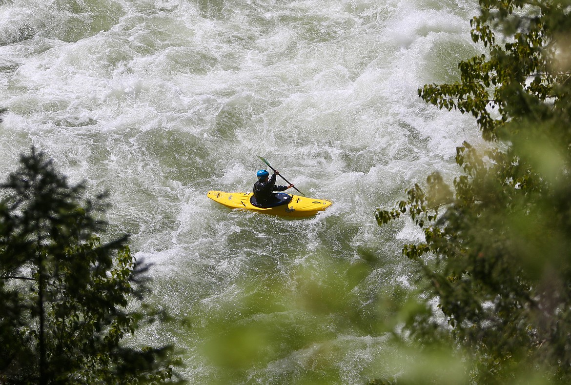 A kayaker floats down a more mild section of the Wild Mile at the Bigfork Whitewater Festival on Saturday, May 29. Mackenzie Reiss/Bigfork Eagle