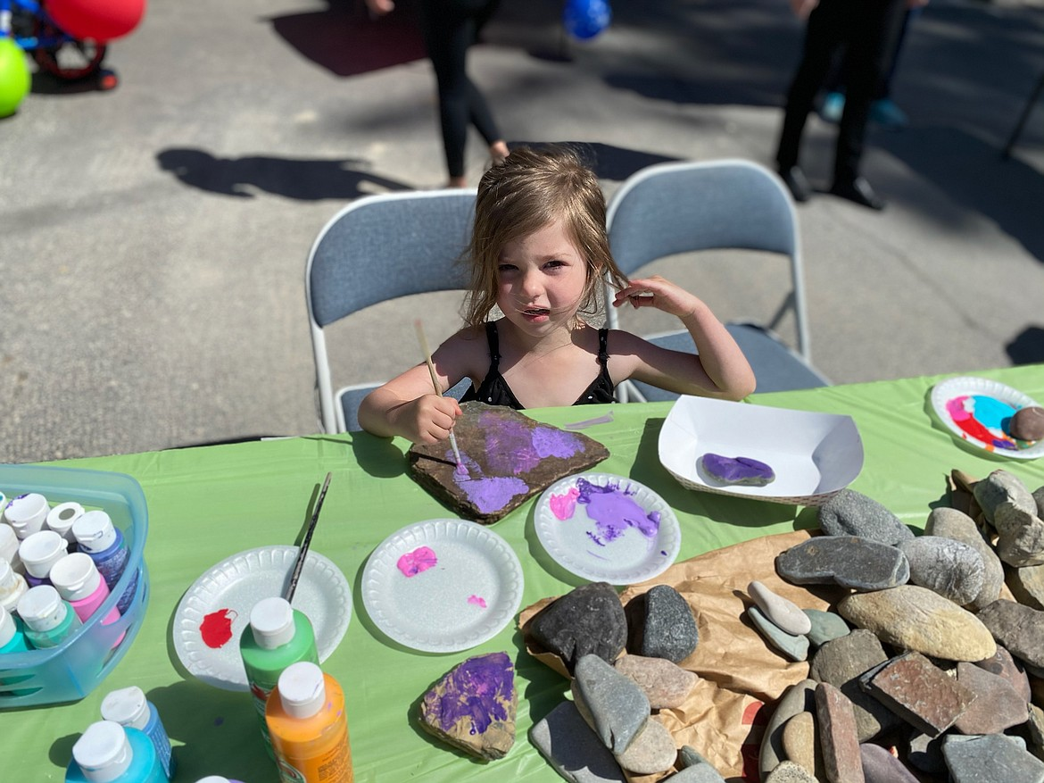 A little girl pants rocks at the Hope Preschool family day event.