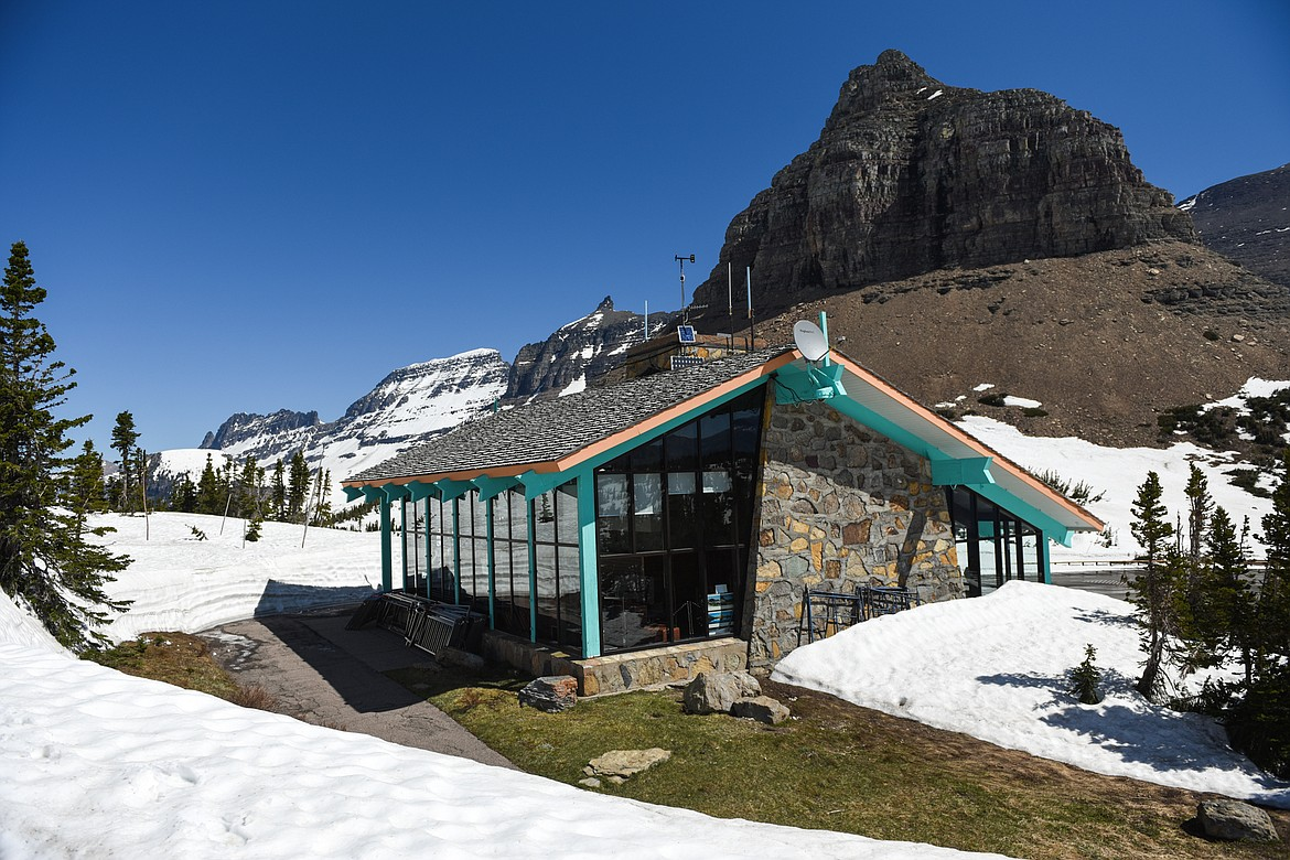 Snow melts around the Logan Pass visitor center during a media tour of the snow removal process at Logan Pass in Glacier National Park on Wednesday, June 2, 2021. (Casey Kreider/Daily Inter Lake)