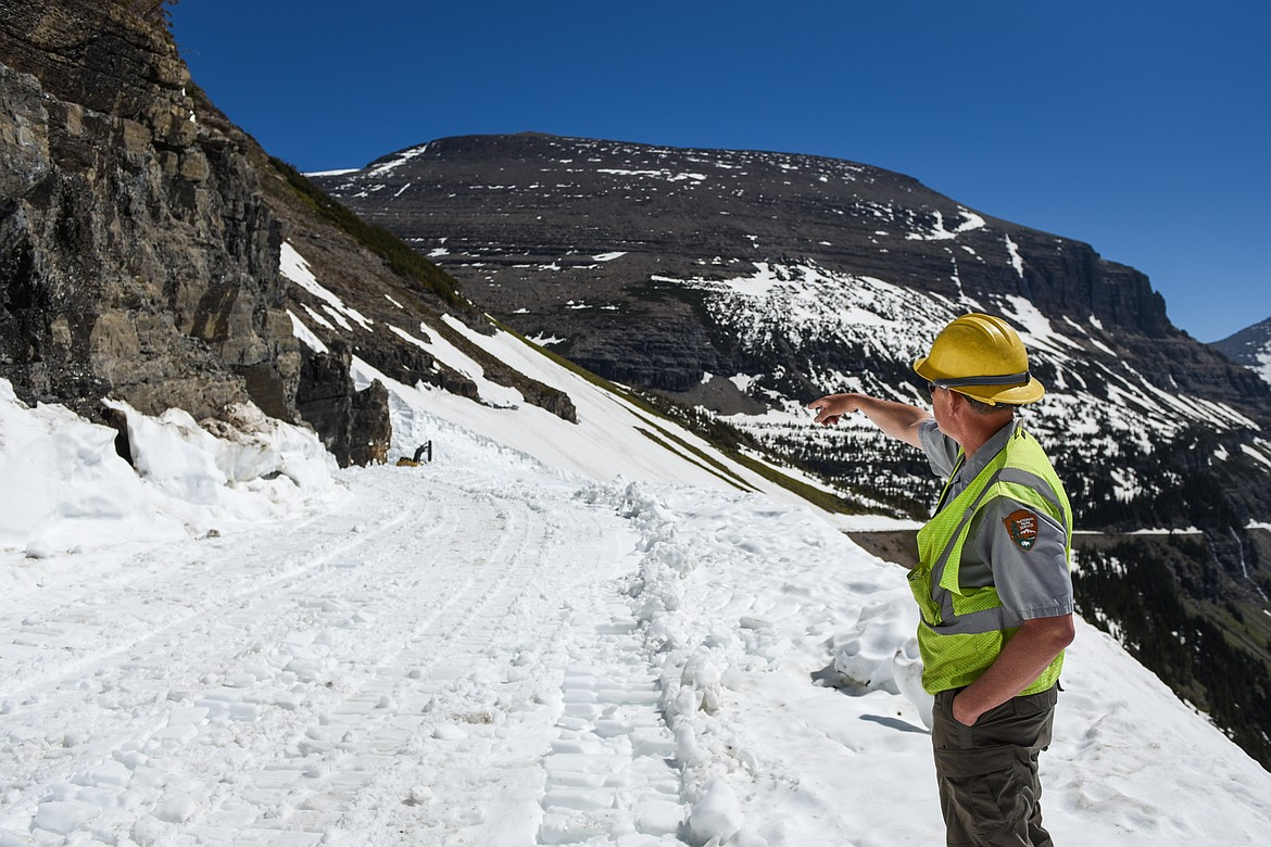 Glacier National Park Road Supervisor Brian Paul gestures to plows working near the Big Drift on the Going-to-the-Sun Road near Logan Pass on Wednesday, June 2, 2021. (Casey Kreider/Daily Inter Lake)