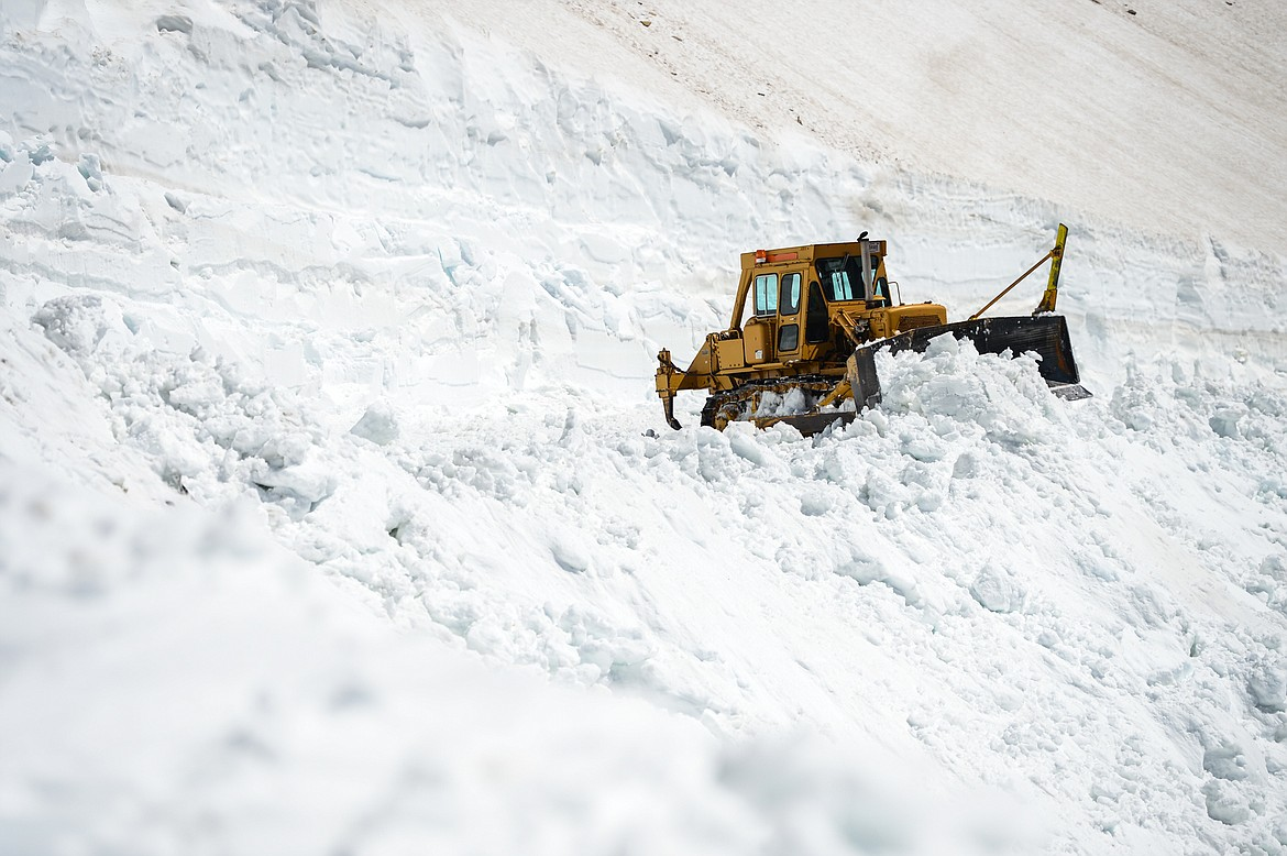 Road crews clear snow at the Big Drift on the Going-to-the-Sun Road near Logan Pass in Glacier National Park on Wednesday, June 2, 2021. (Casey Kreider/Daily Inter Lake)