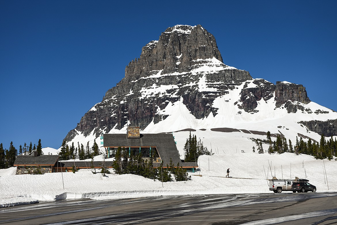 The Logan Pass parking lot and visitors center are pictured during a media tour of the snow removal process at Logan Pass in Glacier National Park on Wednesday, June 2, 2021. (Casey Kreider/Daily Inter Lake)