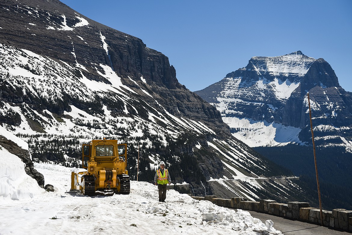 Christian Tranel, work leader with the Glacier National Park roads crew, walks along the Going-to-the-Sun Road near Logan Pass in Glacier National Park on Wednesday, June 2, 2021. (Casey Kreider/Daily Inter Lake)