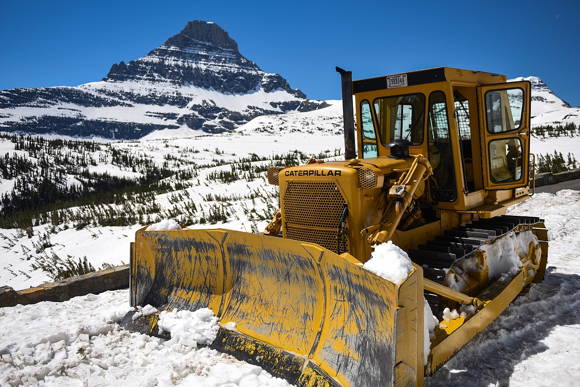 A plow sits near the Big Drift along the Going-to-the-Sun Road in Glacier National Park on Wednesday, June 2, 2021. (Casey Kreider/Daily Inter Lake)