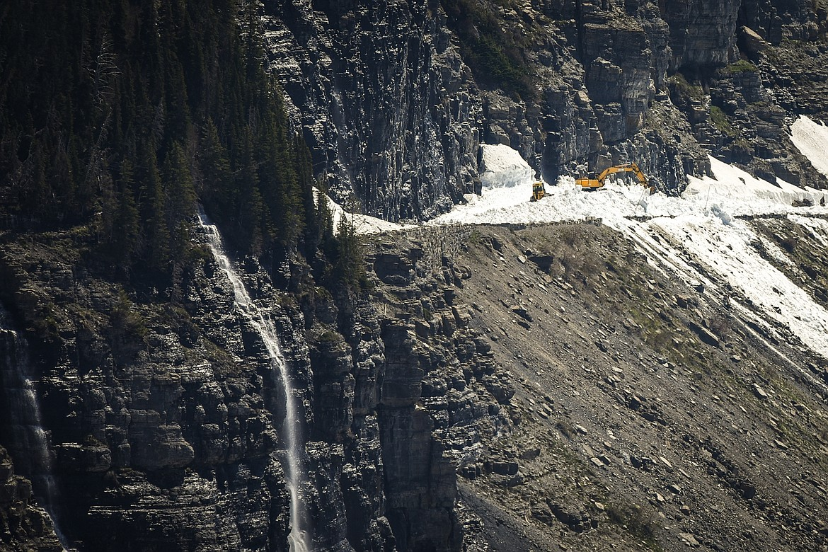 Glacier National Park road crews clear snow from a section of the Going-to-the-Sun Road on Wednesday, June 2, 2021. (Casey Kreider/Daily Inter Lake)